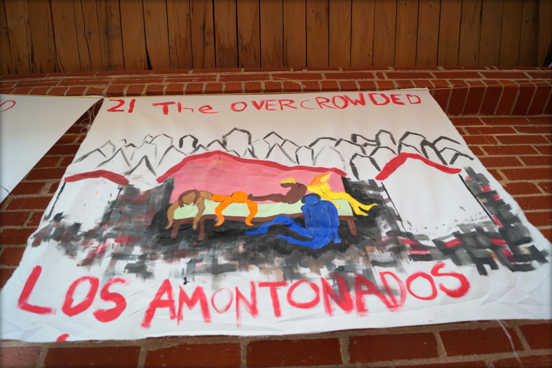 Banner capturing the plight of los amontonados--the overcrowded--in South Los Angeles.