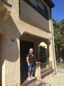 Herlinda Anguiano in front of her home off of Figueroa. Developers plan to bulldoze her home of 40 years.